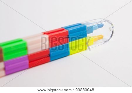 Multicolored Crayons On A White Paper Background.