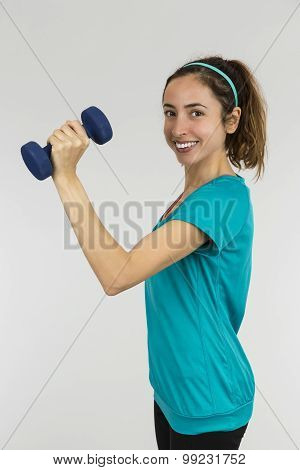 Active Woman Lifting Dumbbell