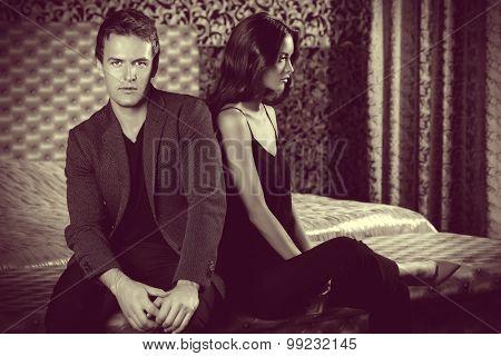 Beautiful couple in love in bedroom. Luxury.