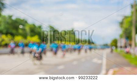 Blur Image Of Asphalt Road And Bike For Background Usage.