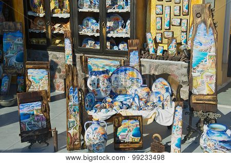 Exterior of the souvenir shop at sunset in Oia, Greece.