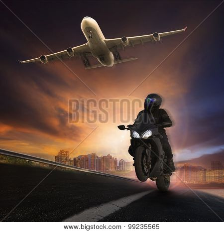 Young Man Riding Motorcycle On Asphalt Highways Road With High Speed And Jet Plane Flying Over Sky
