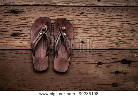 Leather Sandals On Old Wood Background