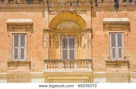 three windows in Mdina, Malta