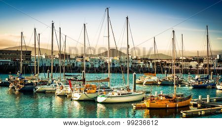 yacht bay on amazing backgrount with city and mountains