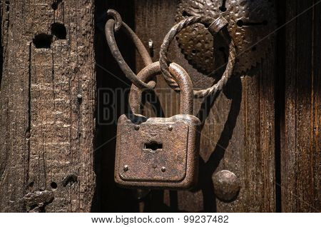 Old rusty padlock with rings