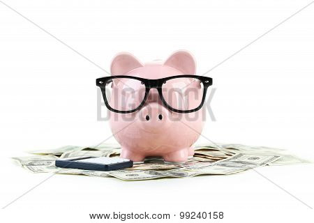 Pink Piggy Bank With Glasses On Dollars Isolated On A White