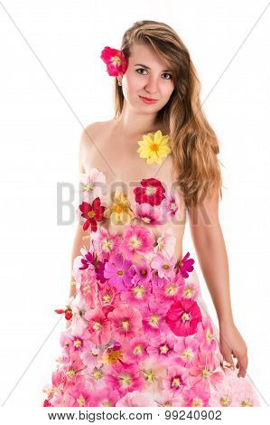 beautiful woman in a dress from flowers