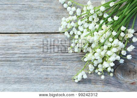 Lily Of The Valley On Grey Wooden Background