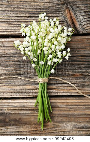 Lily Of The Valley On Brown Wooden Background