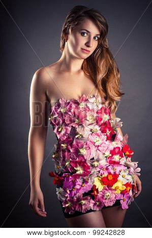 portrait of a beautiful woman in a dress from flowers