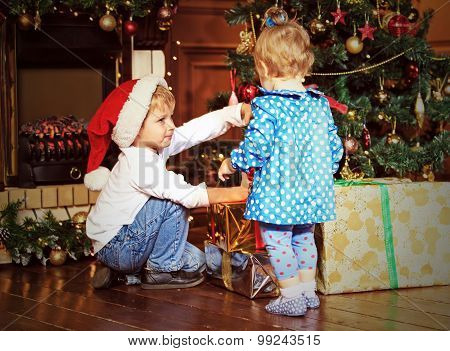 kids taking presents in christmas interior