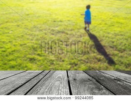 Blurr Shot Of Little Boy Running In The Grass Field.