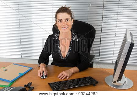 Business woman happy, smiling at the camera