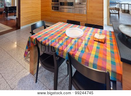 Interior of a modern apartment, wide domestic kitchen, dining table view