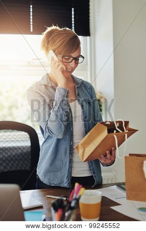 Smiling Female Entrepreneur Taking Orders