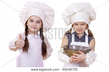 Cooking and people concept - Two Little girls in a white apron, isolated on white background