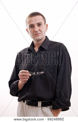 Portrait Of Man In Black Shirt On A White Background