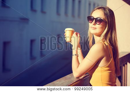Beautiful Woman with Coffee to Go in the City