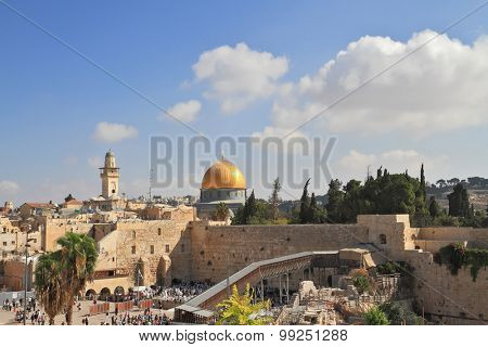 The Western Wall of the Temple and the Mosque of Omar.  The golden dome shines in the morning sun