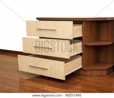 modern wooden nightstand on the floor in bedroom