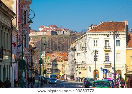 Street view and medieval fortress citadel in Rupea, Brasov, Romania