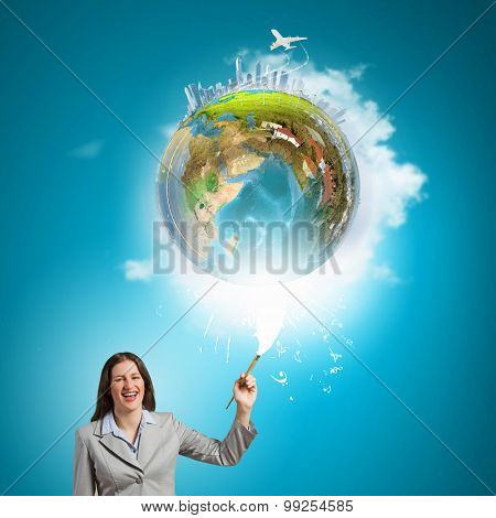 Young pretty businesswoman holding paint brush. Creativity concept. Elements of this image are furnished by NASA