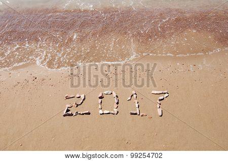 2017 written on sand beach at ocean