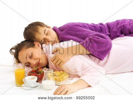 Young Couple In Bed With Breakfast