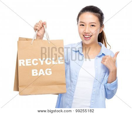 Woman with shopping bag and thumb up for showing recycle bag