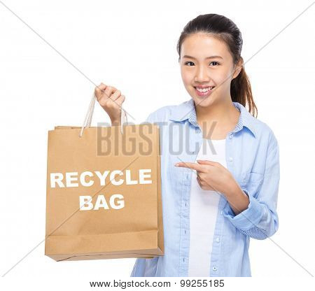 Asian woman finger point to shopping bag and showing recycle bag