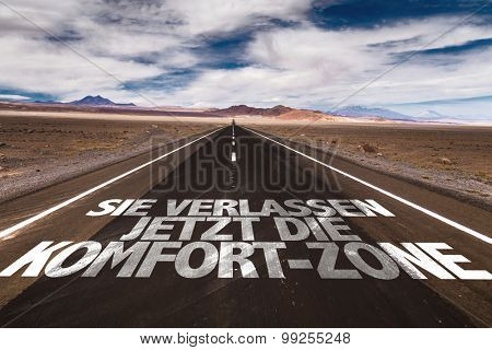 You are now Leaving the Comfort Zone (in German) written on desert road