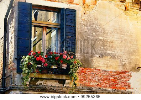 very old window in a building. Quarter of Venice. Italy