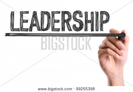 Hand with marker writing the word Leadership