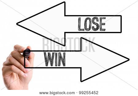 Hand with marker writing the word Lose/Win