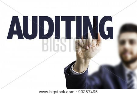 Business man pointing the text: Auditing