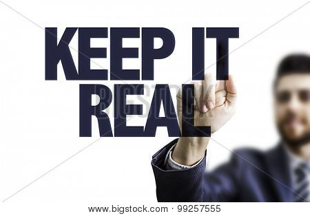Business man pointing the text: Keep It Real
