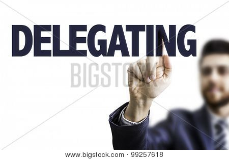 Business man pointing the text: Delegating