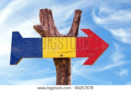 Romania Flag wooden sign with sky background