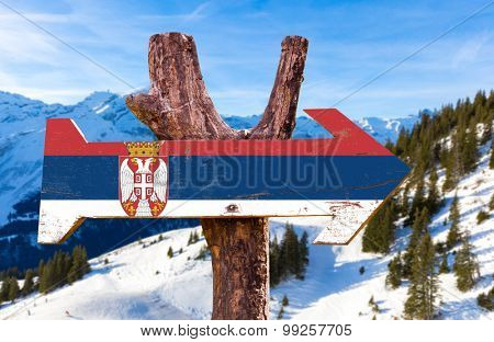 Serbia Flag wooden sign with winter background