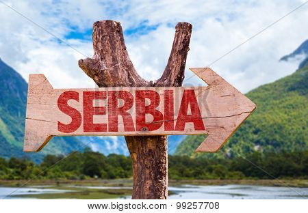 Serbia wooden sign with mountains background