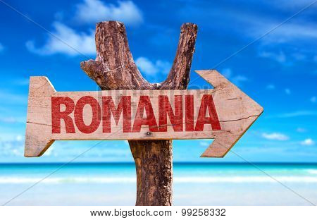 Romania wooden sign with beach background
