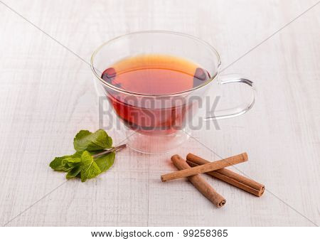 Cup of tea with cinnamon and mint.