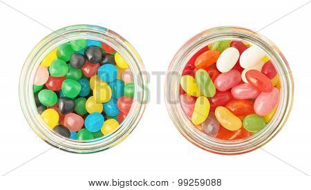 Two jars full of different kinds of candies