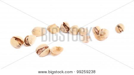 Pile of multiple pistachios isolated