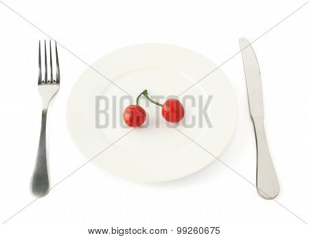 Cherry fruit in a plate isolated