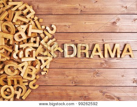 Word drama made with wooden letters
