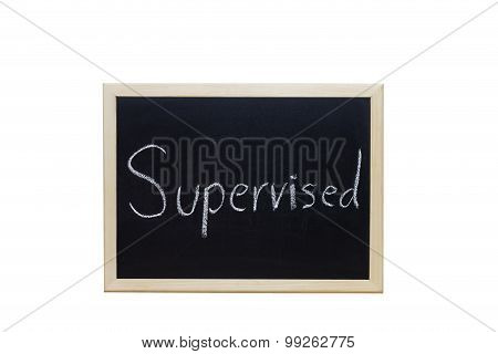 Supervised Written With White Chalk On Blackboard.