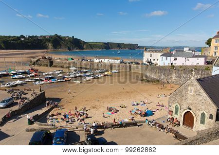 Tenby harbour and beach South Wales beautiful weather and summer August sunshine atracted visitors