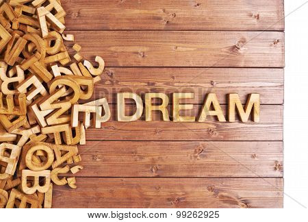 Word dream made with wooden letters